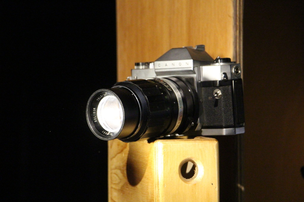 Vintage slr with 8 watt led spotlight.
